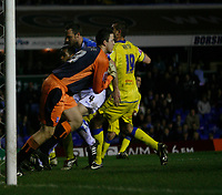 Birmingham keeper Colin Doyle gathers safely under pressure from Leeds Matt Heath