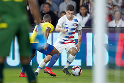 March 21, 2019 - Orlando, FL, U.S. - ORLANDO, FL - MARCH 21: United States midfielder Christian Pulisic (10) battles with Ecuador midfielder Carlos Gruezo (8) in game action during an International friendly match between the United States and Ecuador on March 21, 2019 at Orlando City Stadium in Orlando, FL. (Photo by Robin Alam/Icon Sportswire) (Credit Image: © Robin Alam/Icon SMI via ZUMA Press)
