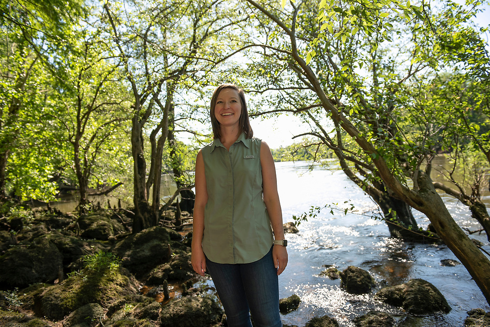 Casey Cox on the banks of the Flint RIver. Casey grew up boating on the river and she talks about it like it is a member of the family.g