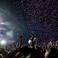 Participants cheer in the audience as singer Prince performs on main stage during his concert on Sziget festival held in Budapest, Hungary on August 09, 2011. ATTILA VOLGYI