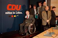 18 JAN 2000, BERLIN/GERMANY:<br /> Wolfgang Schäuble, CDU Parteivorsitzender, und hinter ihm Angela Merkel, CDU Generalsekretärin, auf dem Weg zur Pressekonferenz zu den Ergebnissen der Sitzung des CDU Bundesvorstandes in Verbindung mit der Parteispendenaffäre, Konrad-Adenauer-Stiftung<br /> Wolfgang Schaeuble, Chairman of the Christian Democratic Union (CDU), in his wheel-chair and behind him Angela Merkel General Secretary, on their way to the press conference about the results of the executive committees deliberations about the affair of secret donations to the CDU<br /> IMAGE: 20000118-01/01-28<br /> KEYWORDS: Parteispenden, Affäre, Logo, sign