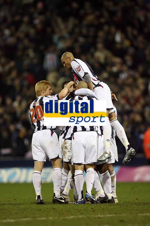 Photo: Rich Eaton.<br /> <br /> West Bromwich Albion v Preston North End. Coca Cola Championship. 26/12/2006. Nathan Ellington (hidden) scores in the second half to make it 4-2 to West Brom and is congratulated by teammates Diomansy Kamara (top)
