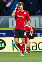 Football - 2013 / 2014 Premier League - Cardiff City vs. Hull City<br /> <br /> Magnus Wolff Eikrem of Cardiff looks down afer the final whistle blows & Cardif lose 4-0 at Cardiff City Stadium.<br /> <br /> COLORSPORT/WINSTON BYNORTH