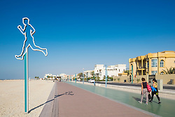 New public boardwalk and jogging track beside beach and lined with luxury villas  in Dubai United Arab Emirates