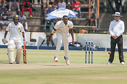 Zimbabwe bowler Carl Mumba in action during the 100th test match played by Zimbabwe in a match with Sri Lanka at Harare Sports Club 29 October 2016.