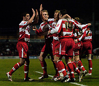 Photo: Jed Wee.<br /> Doncaster Rovers v Arsenal. Carling Cup. 21/12/2005.<br /> <br /> Doncaster celebrate with scorer Paul Green (C).