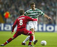Photo. Aidan Ellis.<br />Celtic v Lyon.<br />UEFA Champions League Group A Phase 1.<br />30/09/2003.<br />Celtic's Stanislav Varga and Lyon's Juninho
