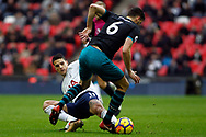 Erik Lamela of Tottenham Hotspur (L) tackles Wesley Hoedt of Southampton (R). Premier league match, Tottenham Hotspur v Southampton at Wembley Stadium in London on Boxing Day Tuesday 26th December 2017.<br /> pic by Steffan Bowen, Andrew Orchard sports photography.