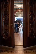 A bride and groom sit in the ballroom at the Crocker Art Museum. Crocker Art museum wedding photography by Kristina Cilia Photography in Vacaville, CA