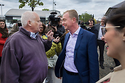 © Licensed to London News Pictures. 03/05/2017. Kidlington, UK. Local resident Malcom Baker (L) argues with Liberal Democrat leader Tim Farron during a campaign stop in Kidlington. Photo credit: Peter Macdiarmid/LNP