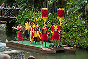"""A reenactment of the Hawaiian royal court in the Canoe Pageant, """"Rainbows of Paradise."""" The Polynesian Cultural Center (PCC) is a major theme park and living museum, in Laie on the northeast coast (Windward Side) of the island of Oahu, Hawaii, USA. The PCC first opened in 1963 as a way for students at the adjacent Church College of Hawaii (now Brigham Young University Hawaii) to earn money for their education and as a means to preserve and portray the cultures of the people of Polynesia. Performers demonstrate Polynesian arts and crafts within simulated tropical villages, covering Hawaii, Aotearoa (New Zealand), Fiji, Samoa, Tahiti, Tonga and the Marquesas Islands. The Rapa Nui (Easter Island) exhibit features seven hand-carved moai (stone statues). The PCC is run by the Church of Jesus Christ of Latter-day Saints (LDS Church). For this photo's licensing options, please inquire."""
