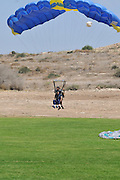 Tandem paragliding Instructor and trainee tied together at landing