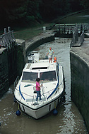 Traveling through a lock by renting a barge and traveling the Midi Canal in France.<br />Photo by Dennis Brack