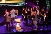Radio Ring Gala 2012 in hetTheater Gooiland, Hilversum.<br /> <br /> Op de foto:  Gerard Ekdom de Gouden Radioring 2012 uit handen van Frits Spits en Freek Vonk