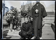 young adult boys posing by family grave Japan ca 1940s