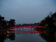 23 DECEMBER 2017 - HANOI, VIETNAM: The foot bridge to the Temple of the Jade Mountain (Ngoc Son Temple) in Hoan Kiem Lake in Hanoi.       PHOTO BY JACK KURTZ