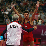 Samuel Mikulak, USA, is congratulated by coach Kurt Golder during the Gymnastics Artistic, Men's Apparatus, Vault Final at the London 2012 Olympic games. London, UK. 6th August 2012. Photo Tim Clayton