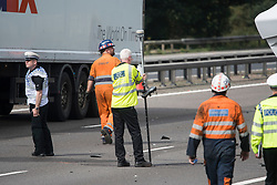 © Licensed to London News Pictures. 26/08/2017. Milton Keynes, UK. A crash investigation team at scene on the M1 motorway near Milton Keynes after a crash involving a minibus and two lorries. Police say that several people are dead and four others have been taken to hospital after the accident on the southbound carriageway in the early hours of this morning. Photo credit: Ben Cawthra/LNP