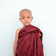Novice monk at the monastery after a Shinbyu Novice Ceremony on 23rd March 2016 in Mo Bye village, Shan State, Myanmar. In Myanmar, it is customary for boys to enter the monastery as a Buddhist novice between the age of ten and 20 years old although they can be as young as four, for at least one week.
