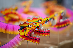 © Licensed to London News Pictures. 22/02/2015. Chinatown, London, UK. Dragon souvenirs on sale as the annual Chinese New Year Parade takes place around Chinatown to celebrate the Year of the Sheep. Photo credit : Stephen Chung/LNP