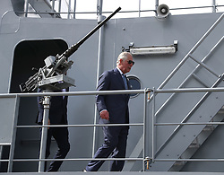 The Prince of Wales walks past a heavy machine gun on a ship during a visit to the Naval Base, near Cork as part of his tour of the Republic of Ireland.