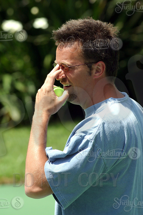 Jul 21, 2002; Holmby Hills, California, USA; Actor MATTHEW PERRY from 'Friends' adjusts his eyeglasses while playing tennis @ the Playboy Mansion for the 30th year of the Merchant of Tennis/Monty Hall/Cedars-Sinai Diabetes Tennis Tournament to benefit the Diabetes Center. <br />Mandatory Credit: Photo by Shelly Castellano/ZUMA Press.<br />(©) Copyright 2002 by Shelly Castellano