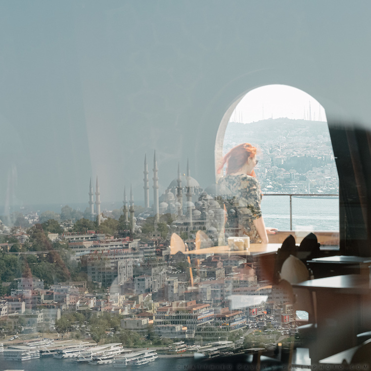 Visitors enjoy the views from the Galata tower to the Golden Horn and the Bosphorus.
