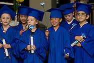 New Windsor, New York - Children stand by the stage after getting their diplomas  as Hudson Hills Academy held its Primary School graduation ceremony on Wednesday, June 11, 2014. The children completed a Montessori program at the school. ©Tom Bushey / The Image Works