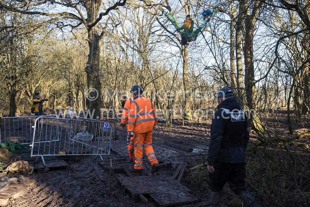 Harefield, UK. 20 January, 2020. Enforcement agents acting on behalf of HS2 enter the Colne Valley wildlife protection camp which was reoccupied by activists from Extinction Rebellion, Stop HS2 and Save the Colne Valley two days previously. Some of the activists, who are seeking to protect ancient woodland threatened by the high-speed rail link, had been evicted from the camp over the course of the previous two weeks.
