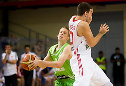 Miha Lapornik of Slovenia vs Ahmet Tuncer of Turkey during basketball match between National teams of Turkey and Slovenia in Qualifying Round of U20 Men European Championship Slovenia 2012, on July 17, 2012 in Domzale, Slovenia. (Photo by Vid Ponikvar / Sportida.com)