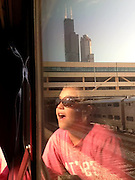 Elli Rose Focht looks at one of the tallest buildings in the world as her train pulls into Chicago.  (model release)