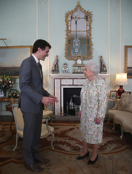 Prime Minister of Canada Justin Trudeau is greeted by Queen Elizabeth II during a private audience at Buckingham Palace, London.