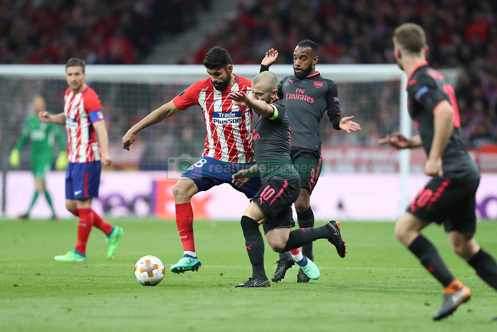May 3, 2018 - Madrid, Spain - DIEGO COSTA of Atletico de Madrid duels for the ball with JACK WILSHERE of Arsenal FC during the UEFA Europa League, semi final, 2nd leg football match between Atletico de Madrid and Arsenal FC on May 3, 2018 at Metropolitano stadium in Madrid, Spain (Credit Image: © Manuel Blondeau via ZUMA Wire)