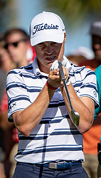 February 28, 2019 - Palm Beach Gardens, Florida, U.S. - JUSTIN THOMAS checks his 9 iron after hitting into a tree on the 10th hole during the first round of the Honda Classic Thursday at PGA National Resort and Spa. (Credit Image: © Allen Eyestone/The Palm Beach Post via ZUMA Wire)
