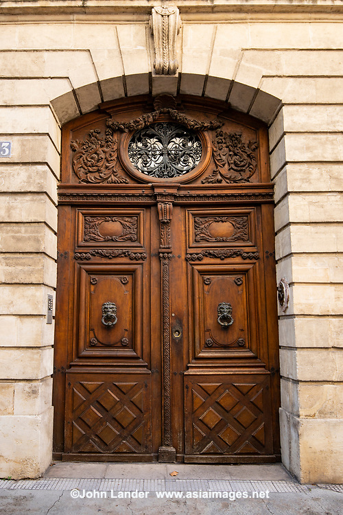 Thousands of doors and gates adorn buildings in France.  Some of the best are on government offices, cathedrals and churches, as well as a few chateau.  However, any self-respecting contractor with a decent budget probably spent a lot of consideration in installing suitable doors, windows, grill work and even doorknobs. Some of these gates, doors and windows are very simple, while others are extravagant works of art. The styles of these doors tell about the history of France. As you walk across the 20 arrondissements of Paris, you will discover Gothic, Renaissance, Haussmann and Art Nouveau door styles. It is up to you to take the time to look for little details of these Paris' most beautiful doors with statues, bas-reliefs, mascarons, gold-leaf, grills, handles and door knobs.