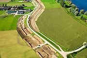 Nederland, Gelderland, Gemeente Buren, 26-06-2013; Rijswijk. Werkzaamheden aan de Rijnbandijk, het kader de  dijkversterking.<br /> Dike reinforcement winter dike lower-rhine.<br /> luchtfoto (toeslag op standaard tarieven);<br /> aerial photo (additional fee required); copyright foto/photo Siebe Swart.