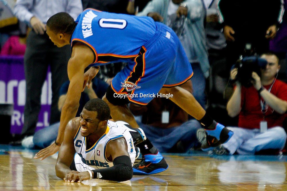 January 24,  2011; New Orleans, LA, USA; New Orleans Hornets point guard Chris Paul (3) collides with Oklahoma City Thunder point guard Russell Westbrook (0) on a fast break attempt during the final minute of the fourth quarter at the New Orleans Arena. The Hornets defeated the Thunder 91-89. Mandatory Credit: Derick E. Hingle