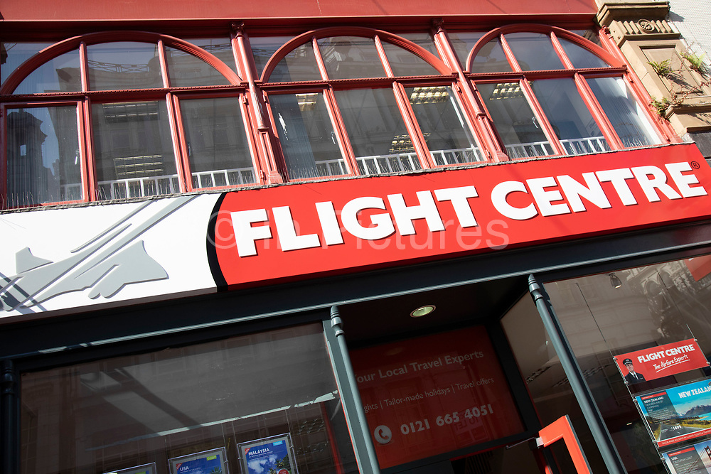Sign for the travel agency brand Flight Centre in Birmingham, United Kingdom.
