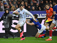 Rugby Union - 2020 Guinness Six Nations Championship - France vs. England<br /> <br /> England's Jonny May evades the tackle of France's Vincent Rattez, at The Stade de France, Paris.<br /> <br /> COLORSPORT/ASHLEY WESTERN