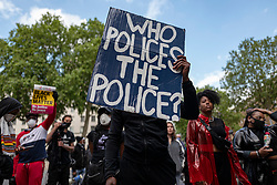 © Licensed to London News Pictures. 09/06/2020. London, UK. Protesters gather outside Downing Street shortly after marking the funeral of George Floyd with a minute's silence in Parliament Square. Protests have taken place across the United States and in cities around the world in response to the killing of George Floyd by police officers in Minneapolis on 25 May. Photo credit: Rob Pinney/LNP