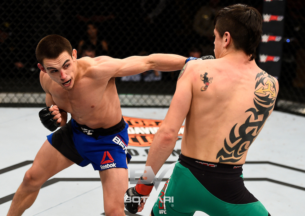 LAS VEGAS, NV - DECEMBER 03:  (L-R) Ryan Benoit punches Brandon Moreno of Mexico in their flyweight bout during The Ultimate Fighter Finale event inside the Pearl concert theater at the Palms Resort & Casino on December 3, 2016 in Las Vegas, Nevada. (Photo by Jeff Bottari/Zuffa LLC/Zuffa LLC via Getty Images)