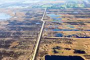 Nederland, Drenthe, Gemeente Emmen, 01-05-2013; natuurreservaat het Bargerveen, restant van het vroegere Boertangemoeras. De landweg loopt door het Amsterdamsche Veld. Na het beeindigen van de vervening in bezit van de Vereniging Natuurmonumenten. Natuurbeheer gericht op ontstaan van levend hoogveen (door vernatting). Onderdeel van Internationaler Naturpark Bourtanger Moor-Bargerveen.<br /> Former swamp and peat area, part of International Nature Park Bourtanger Moor-Bargerveen<br /> luchtfoto (toeslag op standard tarieven);<br /> aerial photo (additional fee required);<br /> copyright foto/photo Siebe Swart.
