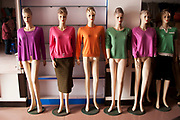 Western showroom dummies in a textiles shop in De Hui, Jilin Province, China. It is common that these manequins are used. You never see a Chinese one.