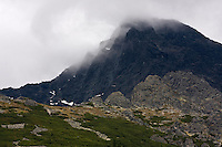 Mount Krivàn (2495 m asl), national symbol of Slovakia. The northern slope covered in clouds. High Tatras, Slovakia. June 2009. Mission: Ticha