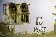 "Graffiti reads ""HIP RAP MUSLIM BIGG"" in an alley in the Chefchaouen medina, Morocco."