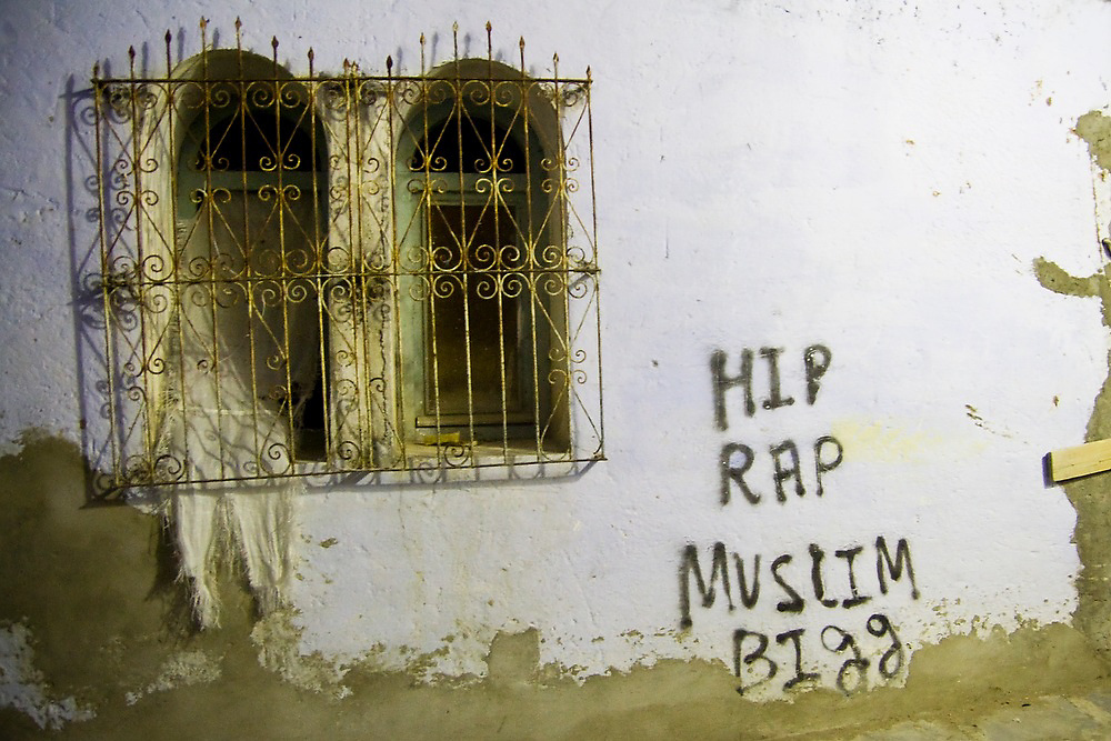"Graffiti reads ""HIP RAP MUSLIM BIGG"" in an alley in the Chefchaouen medina, Morocco."