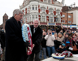 © Licensed to London News Pictures. 24_02_2013..Bobby Moore Wreath laying..West Ham Utd Chairman David Gold with former West Ham utd and England Player Martin Peters lay a wreath at the Statue of Bobby Moore.. During the memeorial service to mark 20 years since the England and West Ham Utd Captain died of cancer at the age of 51.. Photo credit : Andrew Baker/LNP