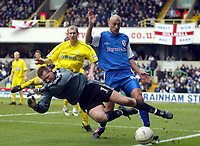 Photo: Scott Heavey.<br />Millwall v Tranmere Rovers. FA Cup 6th Round. 07/03/2004.<br />John Achterberg, the Tranmere keeper is fouled by Danny Dichio
