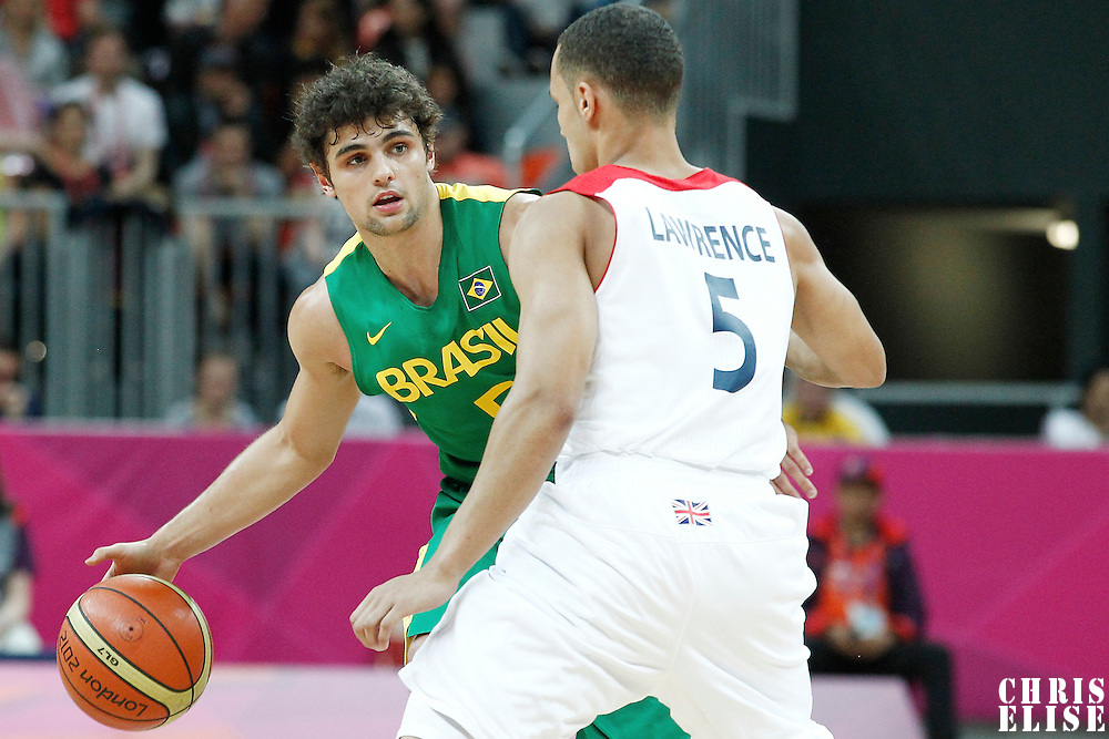 31 July 2012: Brazil Raul Neto looks to pass the ball during 67-62 Team Brazil victory over Team Great Britain, during the men's basketball preliminary, at the Basketball Arena, in London, Great Britain.
