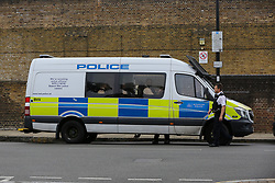 © Licensed to London News Pictures. 04/07/2020. London, UK. Police van near Roman Way, Islington in north London as police launch a murder investigation following fatal shooting. Police were called at at 3.20pm to Roman Way, following reports of shots fired.  Officers attended with LAS and found a man, believed to be aged in his early 20s, suffering from gunshot injuries. Despite their best efforts, he was pronounced dead at the scene. Photo credit: Dinendra Haria/LNP